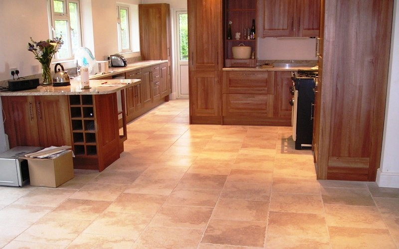 A porcelain 400x600 natural stone style. If you do not like the difference in colour which stone has, using porcelain tiles is the next best thing which is a stronger tile to use and still looks like a stone floor.