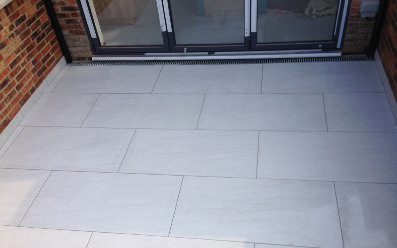 A large tile 1200x600 porcelain tile, the largest tile I have laid but the finish is outstanding. Leading out onto the patio for parties and barbecues.