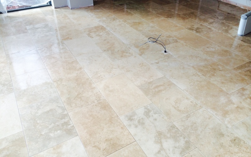 Brick bond design 400x600 honed and filled travertine tiles. We use these tiles a lot in houses, a popular tile choice.
